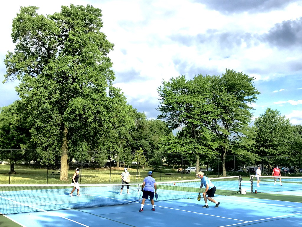 This image shows people playing pickleball.