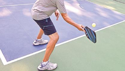Men's Pickleball Shorts: A closeup of someone playing pickleball