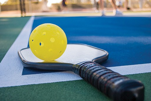 Engage Pickleball vs. Onix Pickleball: In closing, image of pickleball paddle on a court.