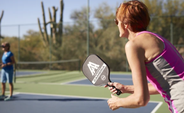 What is a Fault in Pickleball?: Image of people playing pickleball